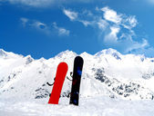 Mountain landscape with two snowboards — Stock Photo