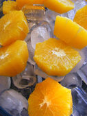 Orange on ice — Stock Photo