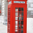 Red telephone booth in London - Stock Photo