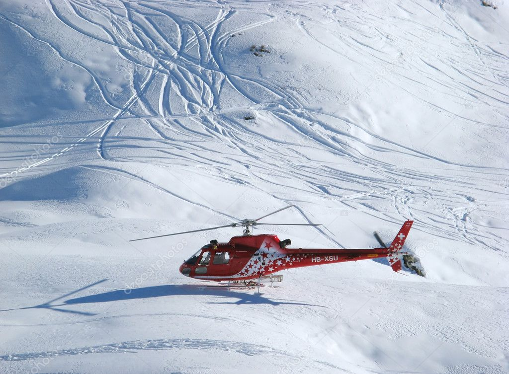 Rescue helicopter on duty in Swiss alps — Stock Photo #1525360