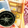 Currency and compass — Stock Photo #1533378