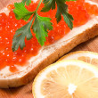 Stock Photo: Sandwich with caviar and lemon