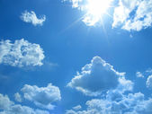 Cloud and sun on blue sky — Stock Photo