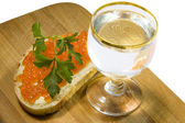 Sandwich with caviar and vodka — Stock Photo