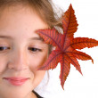 Girl with leaf — Stock Photo