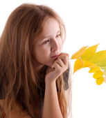 Girl with branchlet — Stock Photo