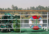 Life buoy on a yacht deck on the river — Stock Photo