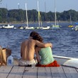 Couple on lake shote — Stock Photo