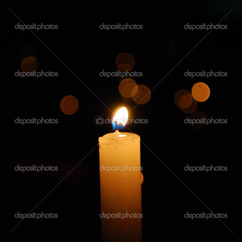 A bright candle on a dark evening — Stock Photo #1523217