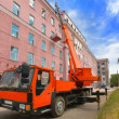 Red Heavy mobile crane truck with bilding — Stock Photo #1523846