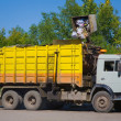 Yellow Garbage Truck - Stock Photo