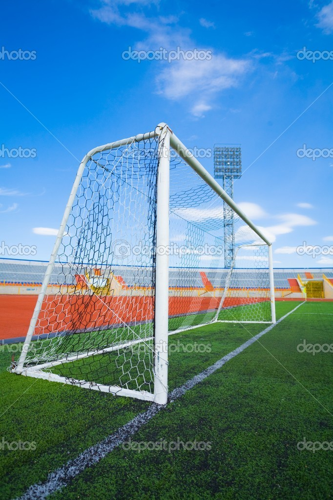 Football field with goal and tablo on blue sky — Stock Photo #1528552