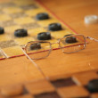 Old glass ,checkers. — Stock Photo