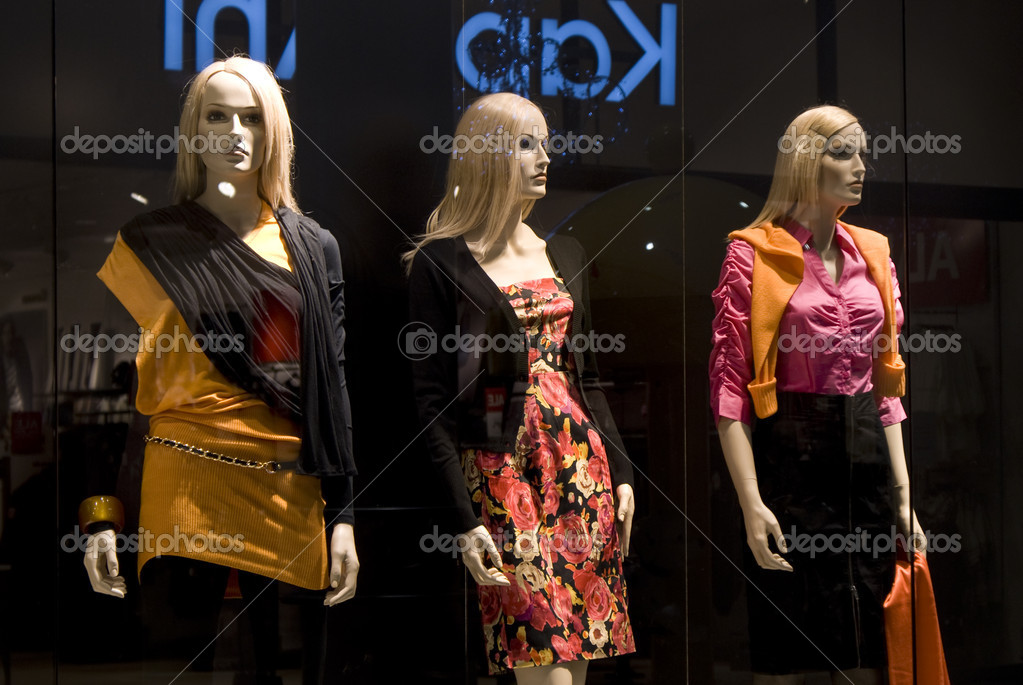 Three dummies in a show-window shop  — Stock Photo #1638589