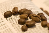 Coffee beans on book — Stock Photo