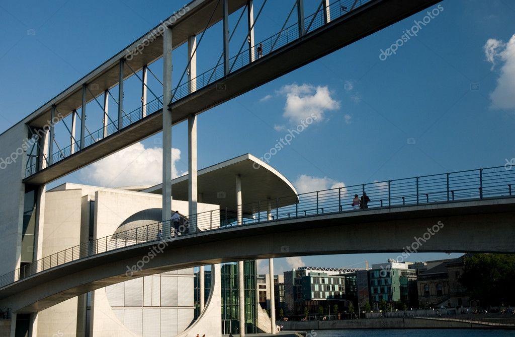 Government buildings in Berlin/Germany, connected with a bridge for passengers — Stock Photo #1553054