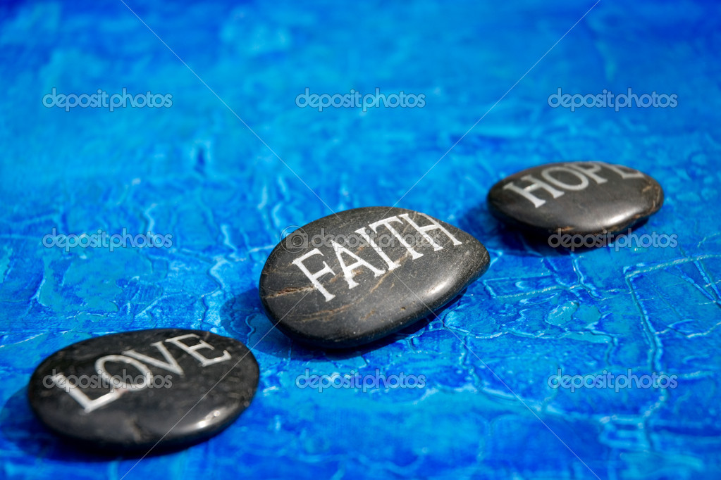 Black pebble with engraving love faith hope — Stock Photo #1582891