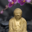 Buddha with Orchid — Stock Photo #1594243
