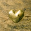 Gold heart on wood — Stock Photo #1609443