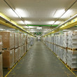 Stock Photo: Storehouse with shrink-wraped palettes