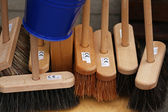 Brooms and bucket — Stock Photo