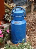 Old blue milk jug — Stock Photo