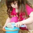 The girl playing to a sandbox — Stock Photo