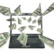 Laptop and dollars — Stock Photo