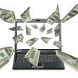 Laptop and dollars - Stock Photo