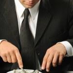 The businessman having dinner dollars — Stock Photo #1525847