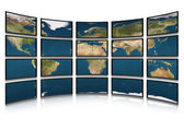 Card earth on screens of monitors — Stock Photo