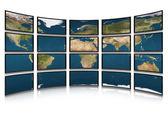 Terra de cartão em telas de monitores — Fotografia Stock