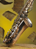 Old saxophone and flying musical notes o — Stock Photo