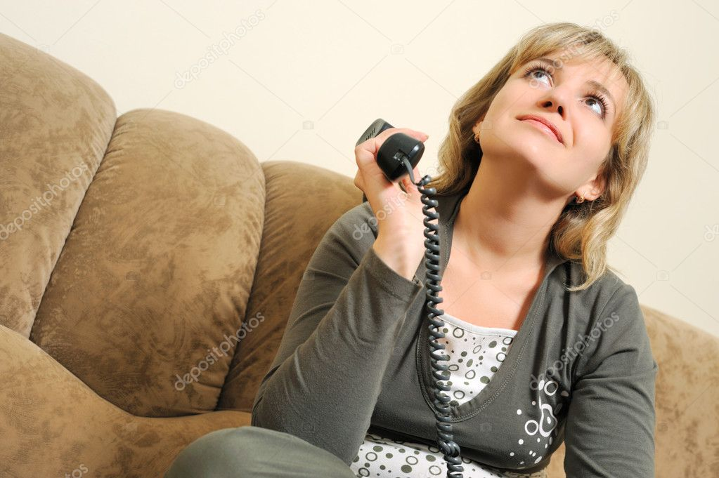 The dreaming woman after dialogue by phone. House conditions — Stock Photo #1526324
