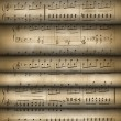 Roll old musical notes — Stock Photo