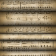 Roll old musical notes - Stock Photo