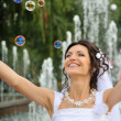 The bride and soap bubbles — Stok fotoğraf