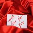 Note on red silk — Stock Photo #2635501