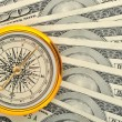 Stock Photo: Dollars and compass
