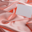 Note on beige silk — Stock Photo