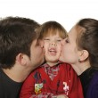 Mum and the daddy kiss the son. — Stock Photo