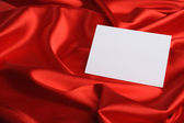 Note on red silk — Stock Photo