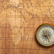 Stock Photo: Compass on old map.