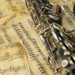 Old saxophone and notes — Stock Photo #2640502
