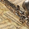 Old saxophone and notes - Stock Photo