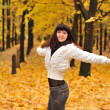 The girl in an autumn forest — Stock Photo