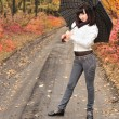 Girl in an autumn wood with a umbrella. — Stock Photo #2641414