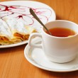 Royalty-Free Stock Photo: Tea and pancakes  with powdered sugar