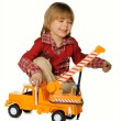 Boy with a toy - a truck crane — Stockfoto
