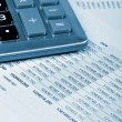 Stock Photo: Calculator and financial report